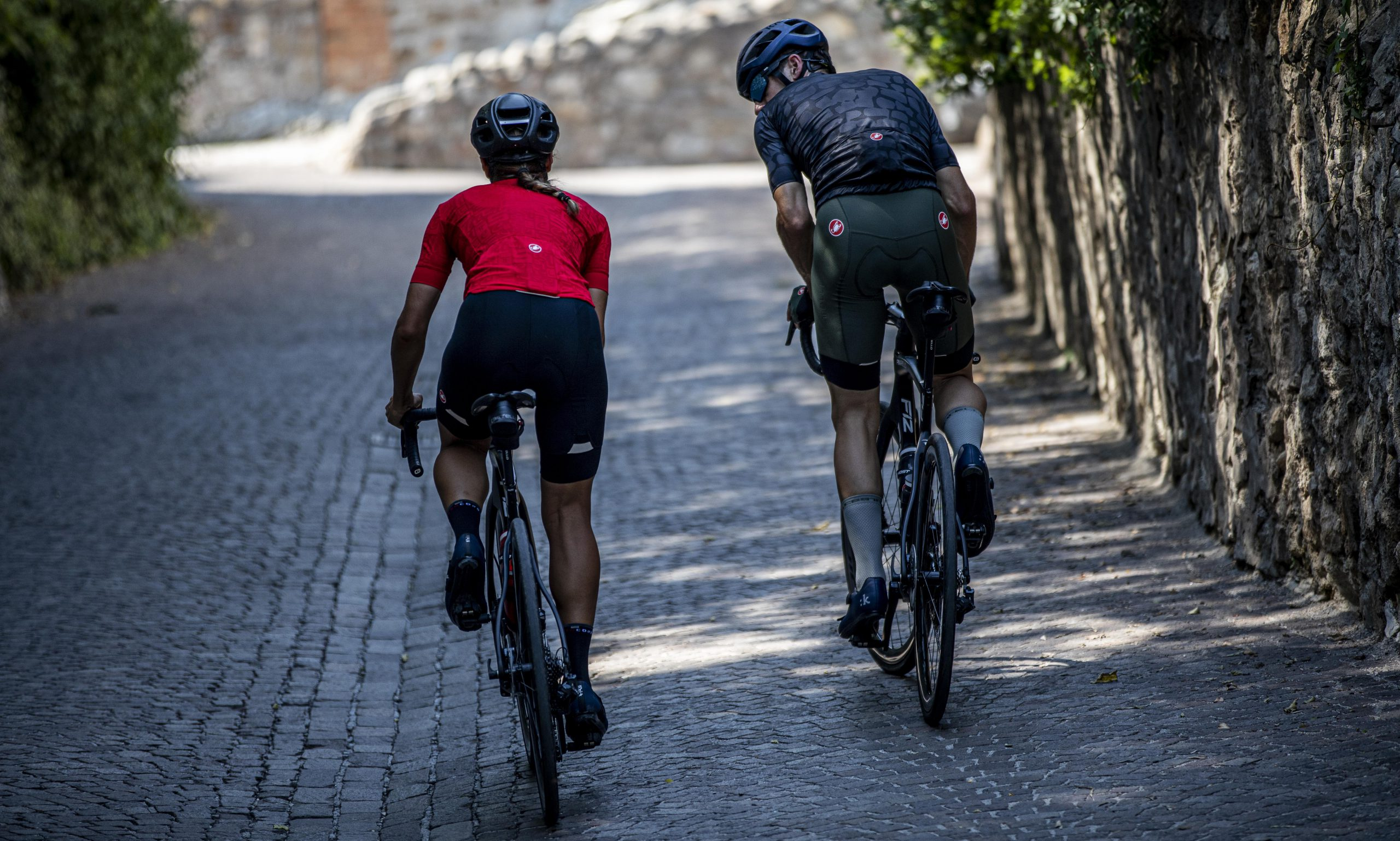 Women and Man Cycling in Castelli Clothing